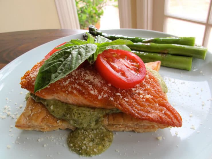 Puff Pastry Salmon with Creamy Pesto - Seared salmon over freshly baked puff pastry, topped with creamy pesto sauce, tomatoes, basil, and cheese. Kosher, Shavuot.