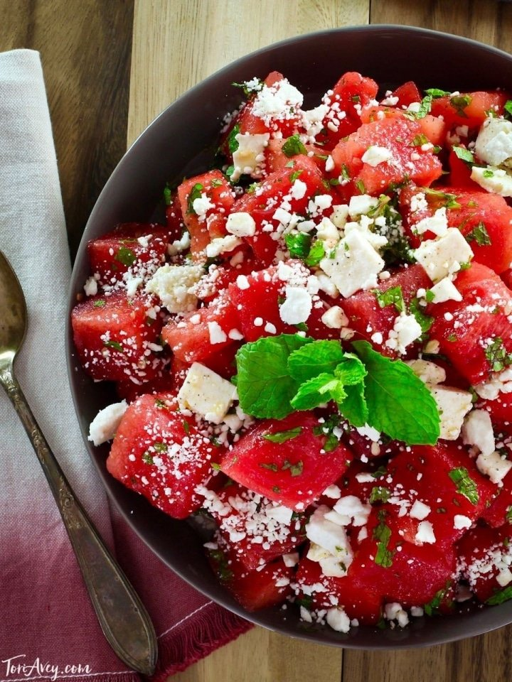 Watermelon Feta Salad with Mint - This refreshing salad with watermelon, feta cheese, and fresh mint is simply dressed with olive oil and lime juice. Perfect for summer.