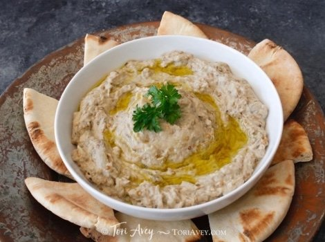 Classic Baba Ghanoush - Recipe for smoky Middle Eastern roasted eggplant dip with tahini, garlic, lemon, olive oil and spices.