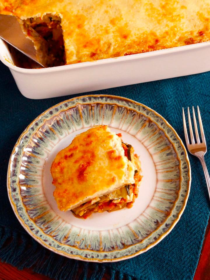 Roasted Vegetable Moussaka - A Mediterranean vegetarian moussaka casserole recipe with roasted eggplants, zucchini, lentils, tomatoes, peppers, spices and rich creamy béchamel sauce.