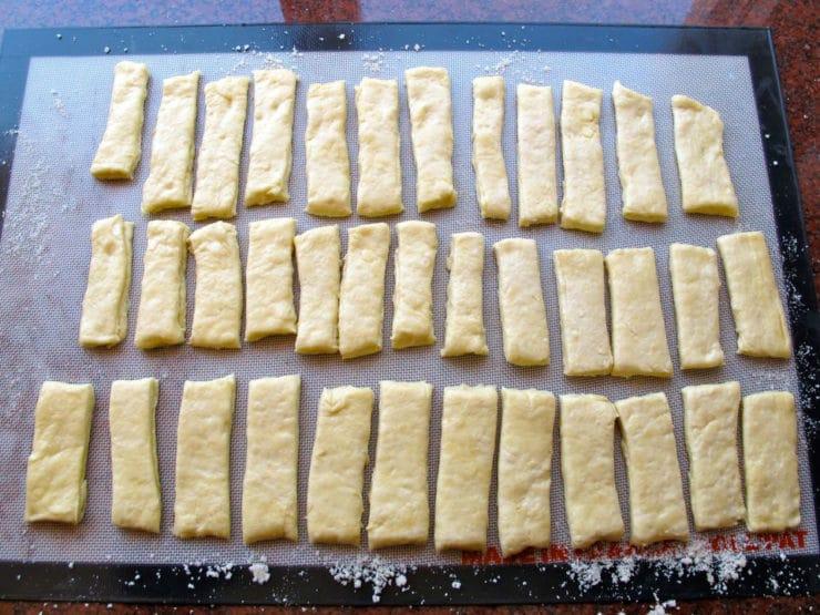 Dough cut into short rectangles.