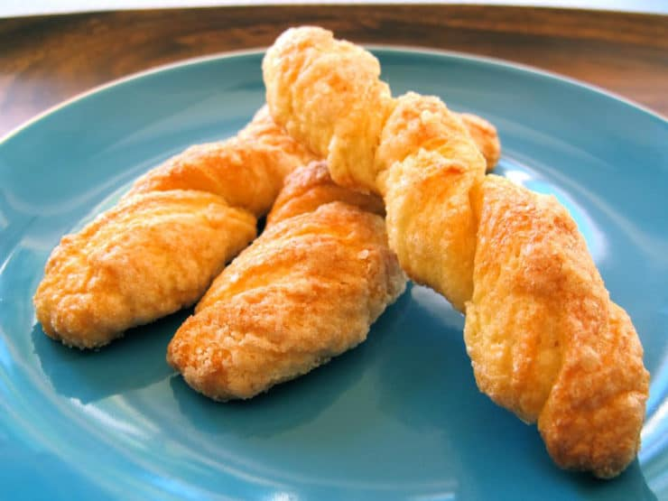 Renée's Sour Cream Twists - A Jewish family recipe for delectable German cookies dipped in sugar and baked to tender-crisp perfection. Kosher, Dairy.