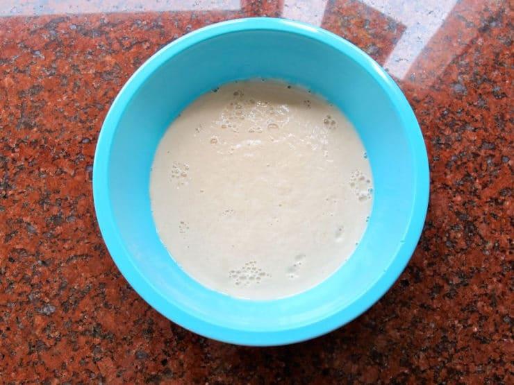 Foamy yeast in a bowl of water.