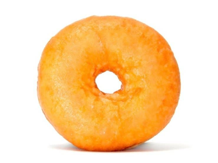 Plain doughnut standing on a white background.