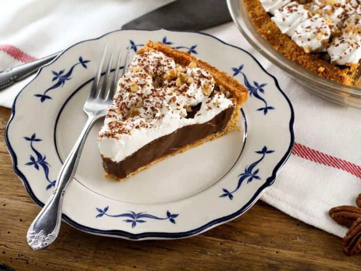 Chocolate Icebox Pie - Learn to make Chocolate Icebox Pie topped with whipped cream and nuts from the vintage 1950's cookbook, Recipes from Old Virginia.