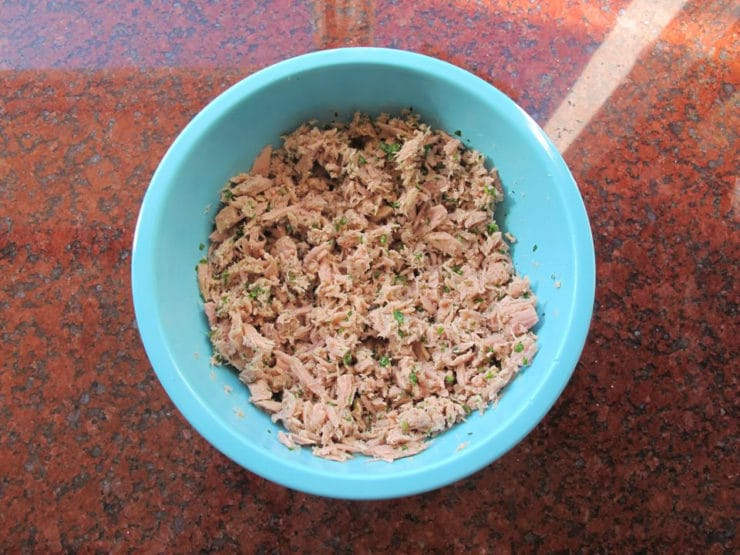 Tuna salad combined in a bowl.