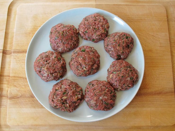 Formed burger patties on a plate.