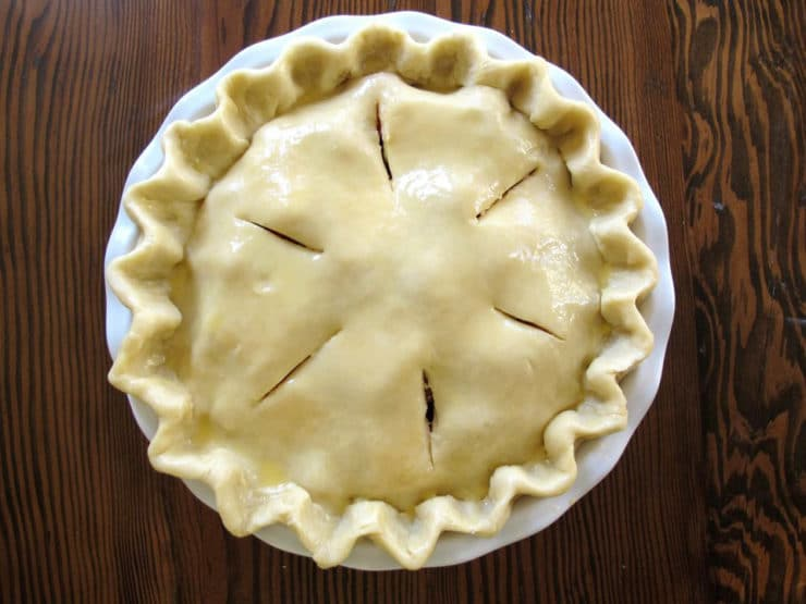 Slits cut into top pie crust.