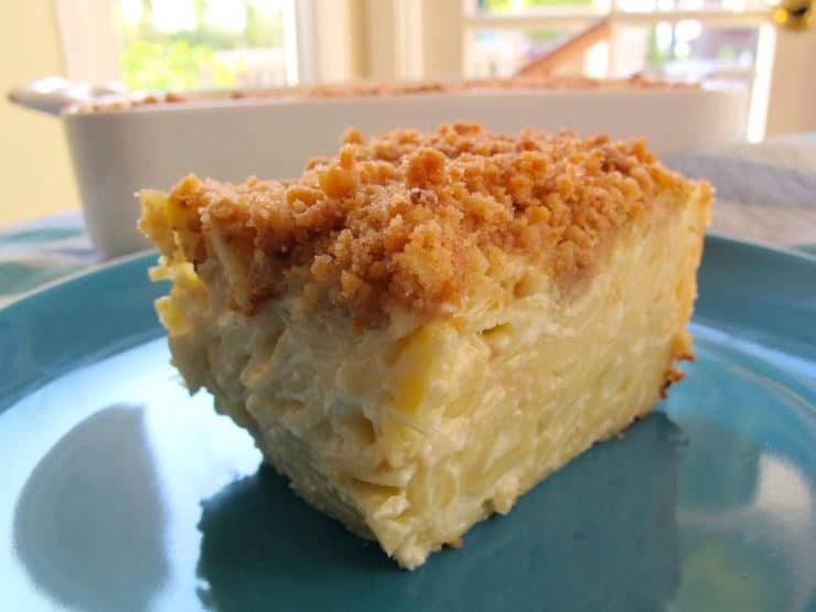 Vanilla Noodle Kugel - This moist, creamy kugel is made with pudding and covered with a crunchy cookie topping. Perfect for potlucks. Kosher, Dairy.
