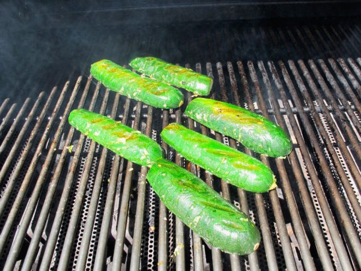 Zucchini halves on a grill, skin side up.