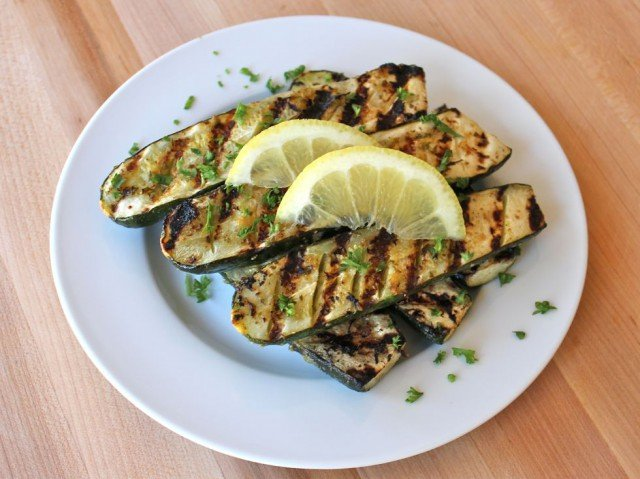 Grilled Lemon Butter Zucchini - Zesty lemon butter and fresh herbs brings out the natural flavor of these lovely grilled courgettes.