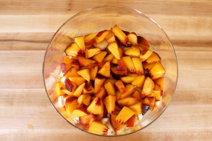 Diced peaches added to trifle dish.