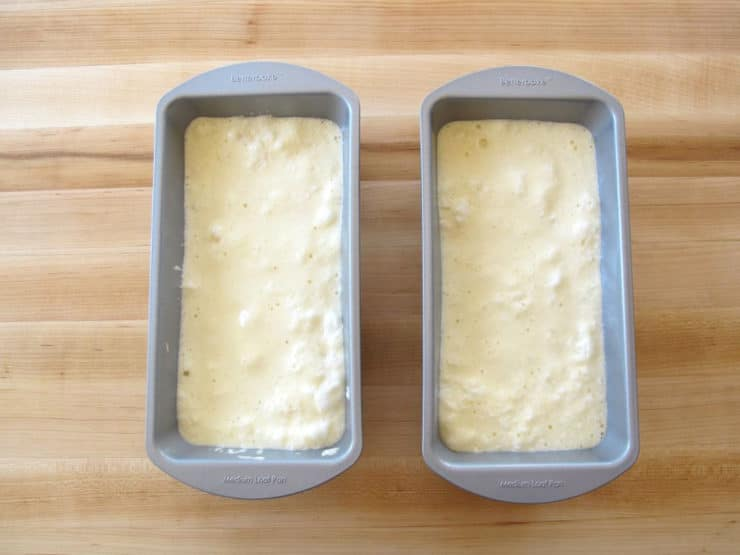 Cake batter split into two loaf pans.