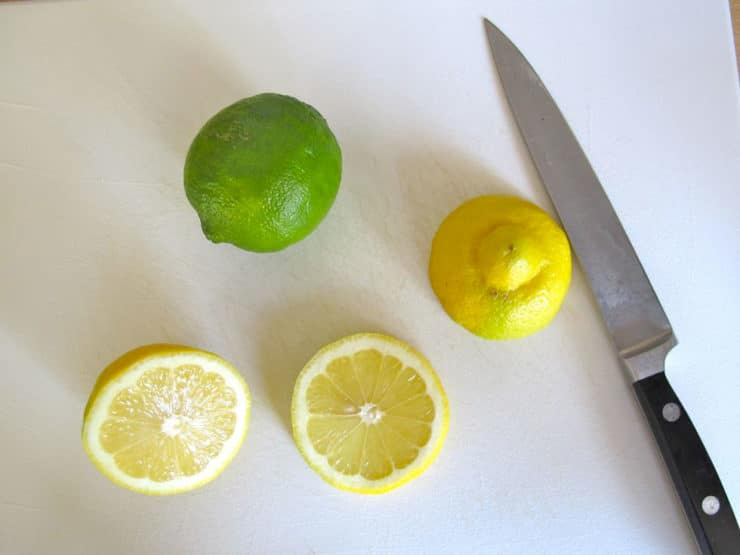 Slicing fresh lemons in rounds.