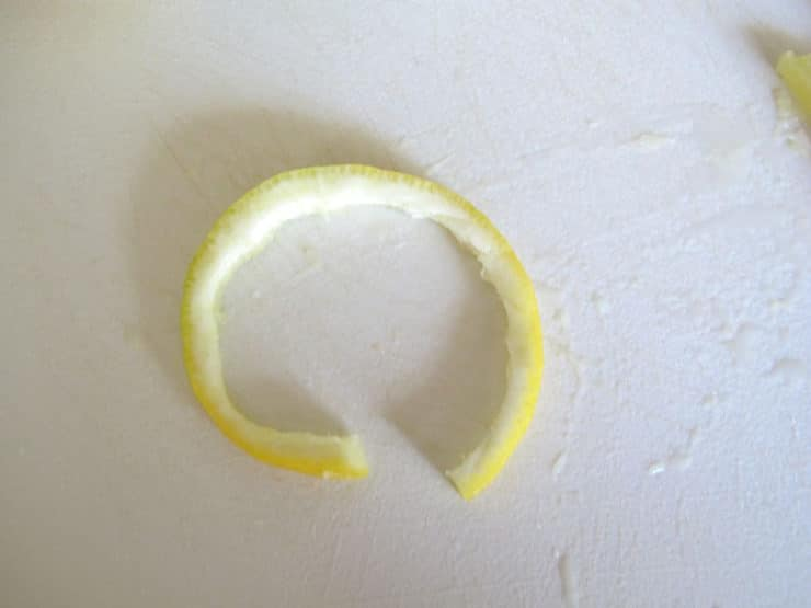 Cut flesh out of lemon round.