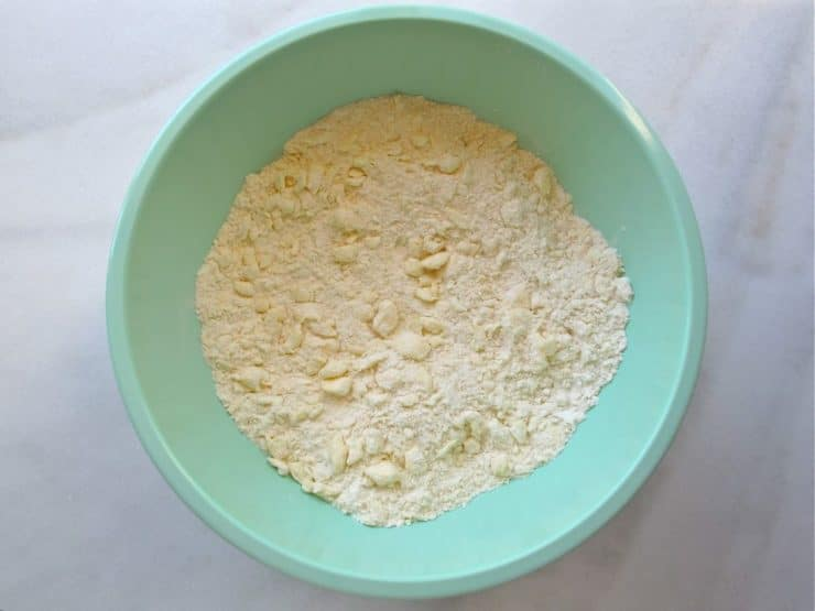 Small crumbles of butter in dry ingredients in mixing bowl.