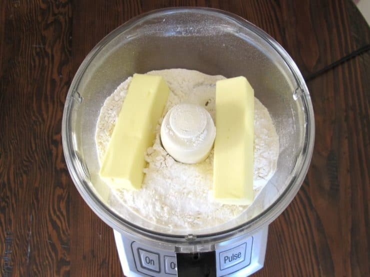 Two sticks of butter in flour in food processor.