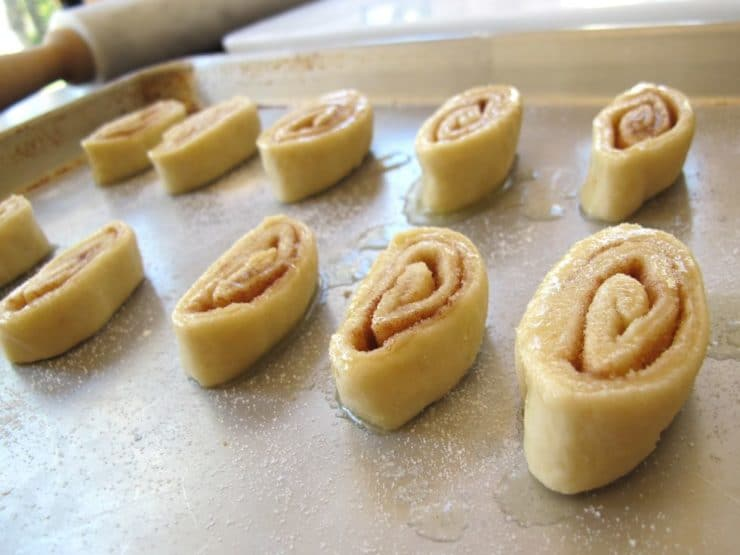 Pie crust pinwheels, unbaked on baking sheet glazed with melted butter.