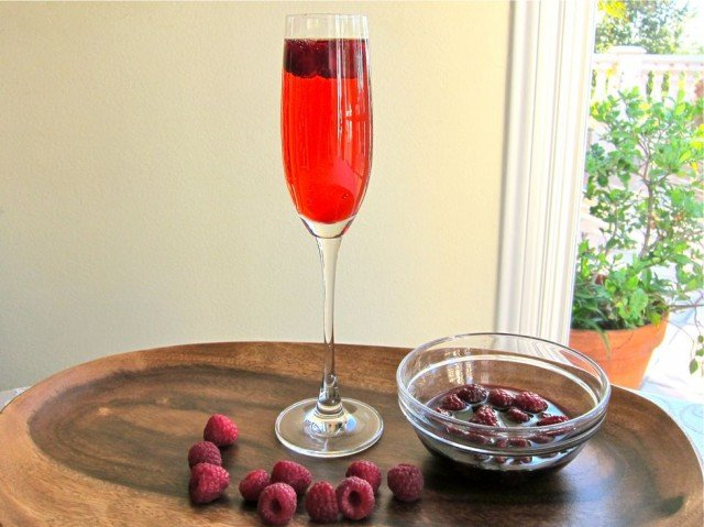 The Razz-Matazz - A delicate sweet cocktail made with Crème de Cassis, Moscato d'Asti, and fresh raspberries. Kosher.