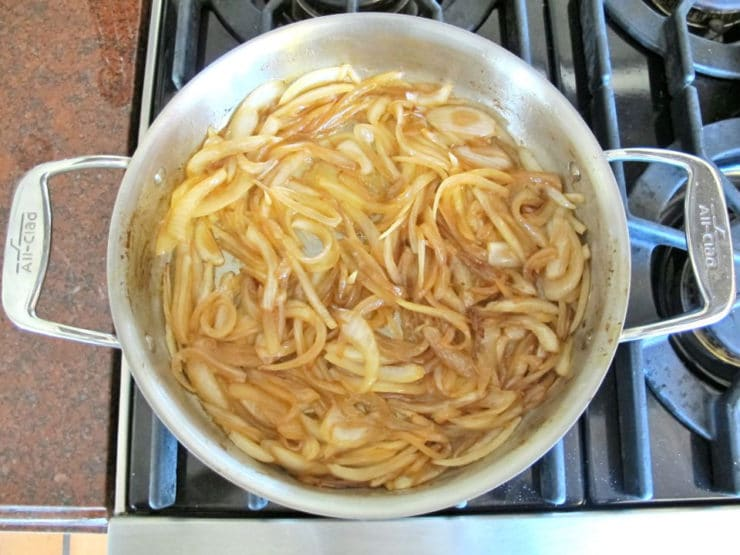Sliced onions browning in a stockpot.