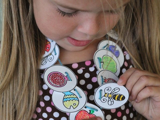 Family Fun: Rosh Hashanah Coloring Sheet & Necklace - A craft for Rosh Hashanah from Brenda Ponnay. Includes printable that can be made into a necklace or a memory game.