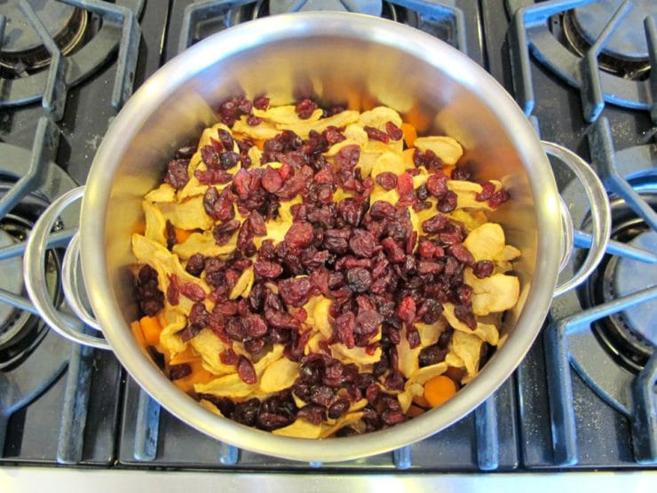 Dried apples and cranberries added to stockpot.