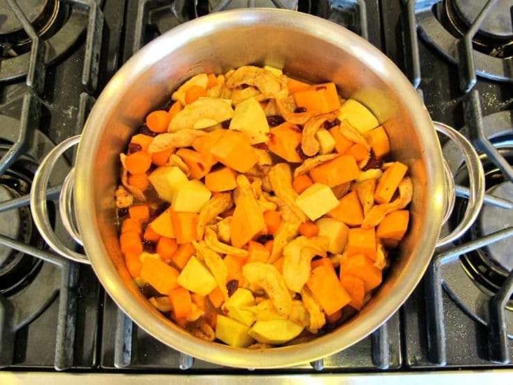 Add chicken broth to vegetables in stockpot.