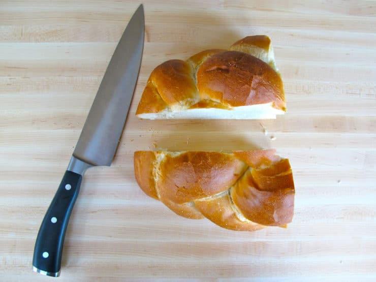 Challah loaf sliced in half.
