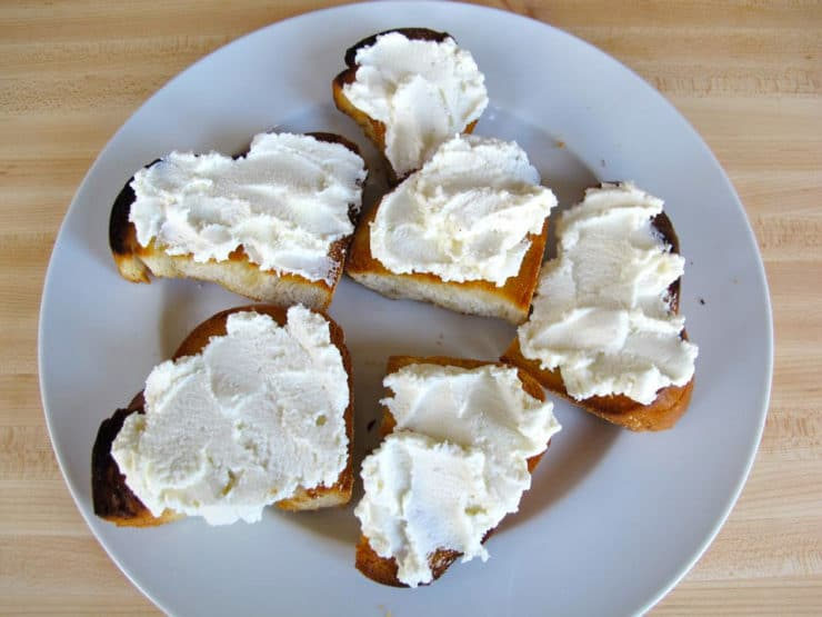 Ricotta spread on sliced, toasted challah.