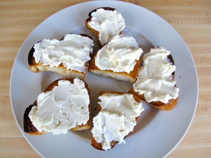Ricotta spread on sliced, toasted challah.