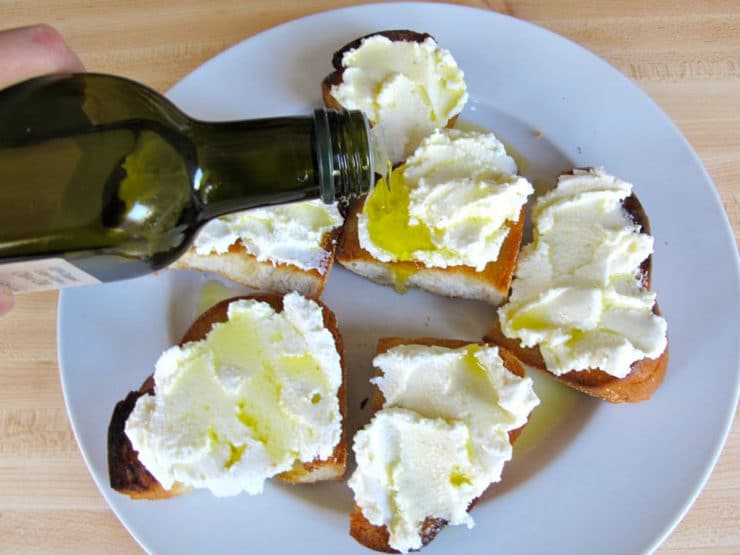 Drizzling olive oil over ricotta challah.