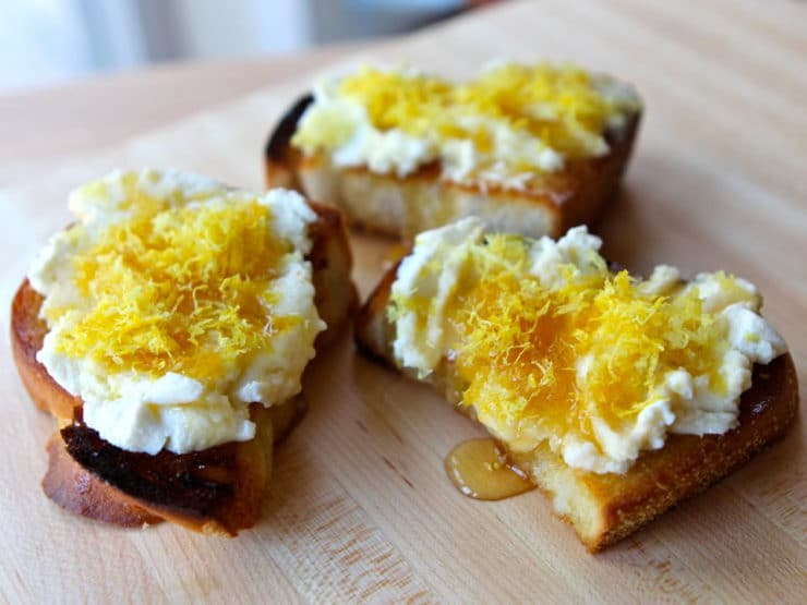 Challah Bruschetta with Lemon Ricotta and Honey - Recipe for challah bruschetta with fresh lemon ricotta, olive oil, honey, lemon zest and salt. Appetizer, kosher, dairy.
