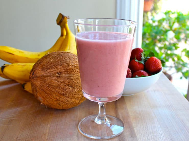 Rejuvenating Coconut Water Smoothie - This creamy coconut water smoothie will rejuvenate and rehydrate. Strawberries, bananas, coconut milk. Dairy free, gluten free