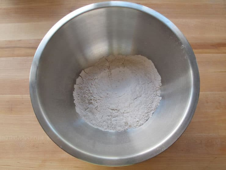 Dry cake ingredients sifted into a bowl.
