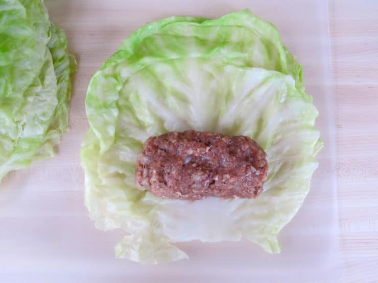 Setting ground meat in a cabbage leaf.