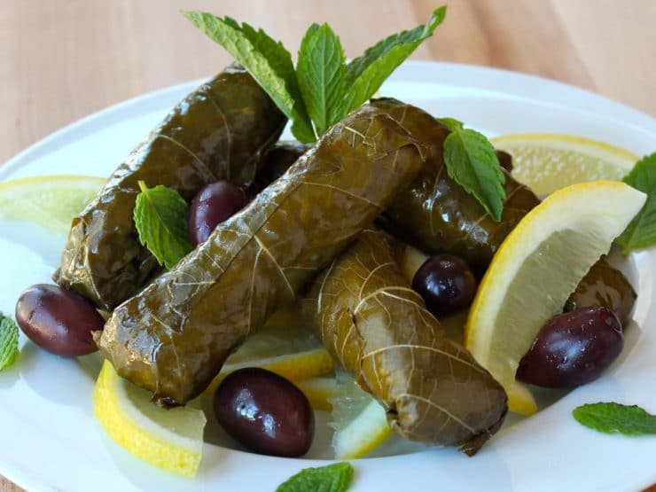 Vegetarian Stuffed Grape Leaves - Learn to make vegetarian stuffed grape leaves, also known as dolmades, with rice, pine nuts, dill, mint, and lemon. Kosher, pareve, gluten free.