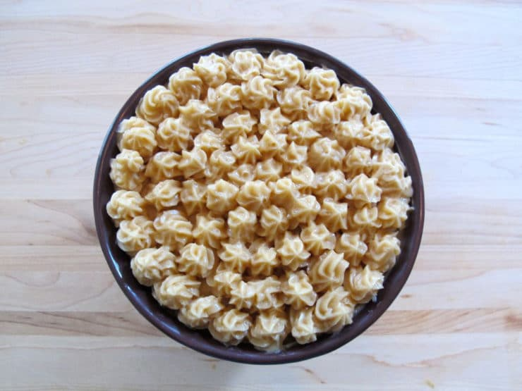 Bowl of butter covered with decorative stars of butter.