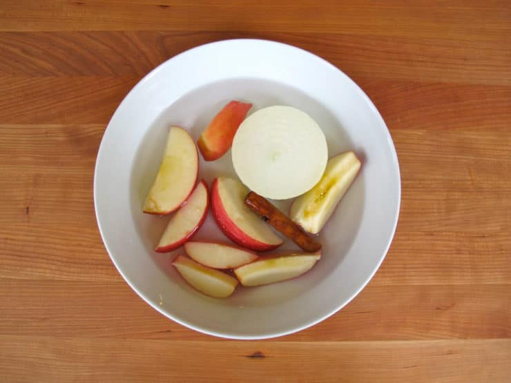 Sliced apples in a small bowl of warm water.