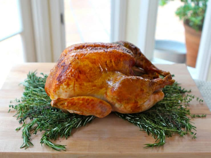 Classic Roast Turkey on a cutting board.