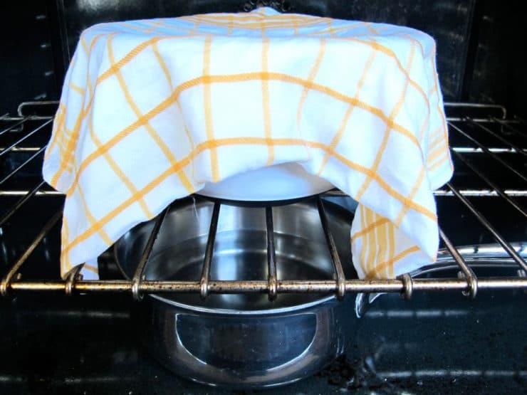 Bread dough proofing in cold oven with hot water.