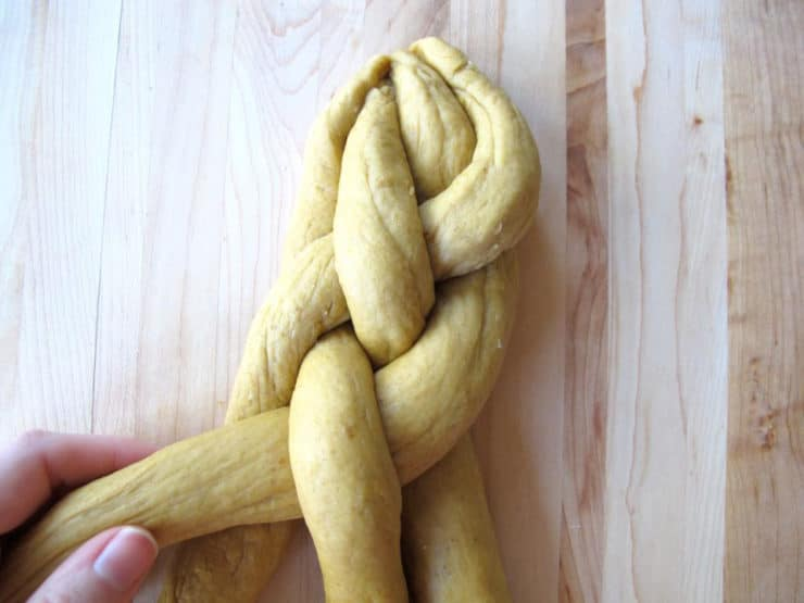 Braid the dough strands in an over under pattern.