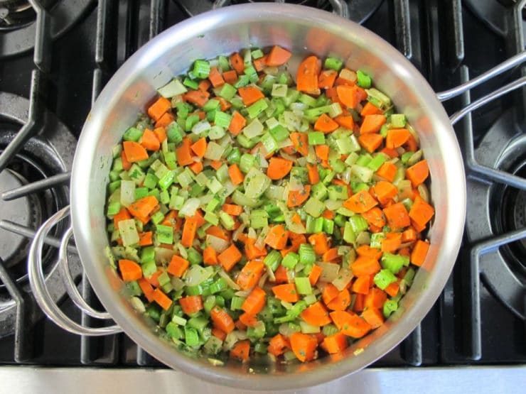 Carrots and celery to saute in a skillet.