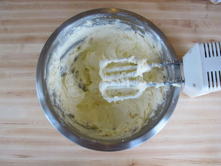 Buttercream frosting whipped in a bowl.