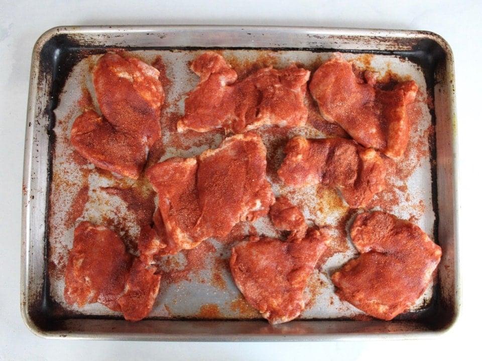 Tray of seasoned smoked paprika chicken, uncooked.