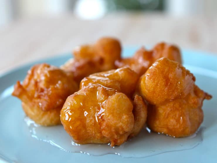 Levivot with Sweet Syrup - Recipe for Levivot, also known as bimuelos. Family recipe from Israel for Hanukkah. Fried batter topped with rose water sugar syrup. Dairy, Kosher, bunuelos