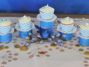 Cupcakes placed on olice cans in Menorah shape.