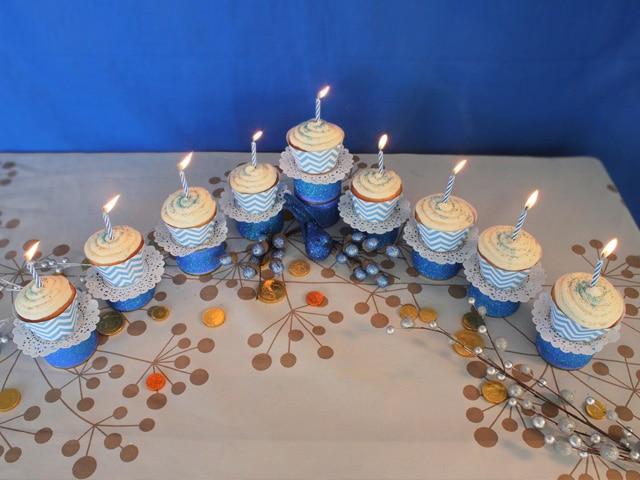 Hanukkah Cupcake Menorah - Learn how to make a Cupcake Menorah for Hanukkah! Includes printable holiday cupcake wrappers. Kosher, craft, project, Chanukah, Chanukkah.