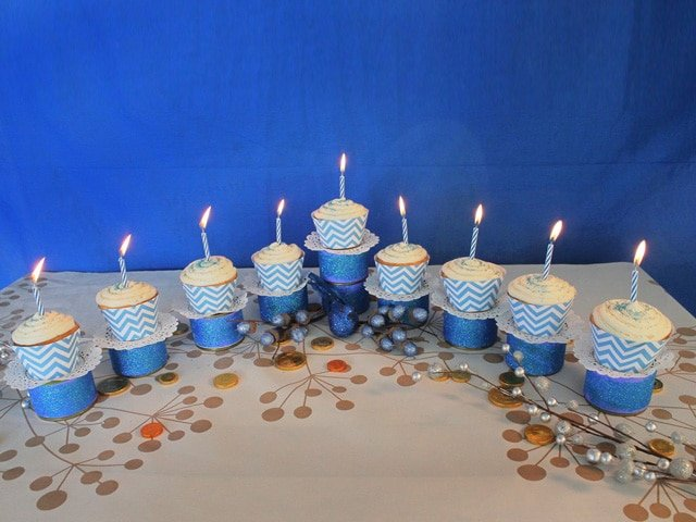 Menorah Cupcakes set up on the table with candles.
