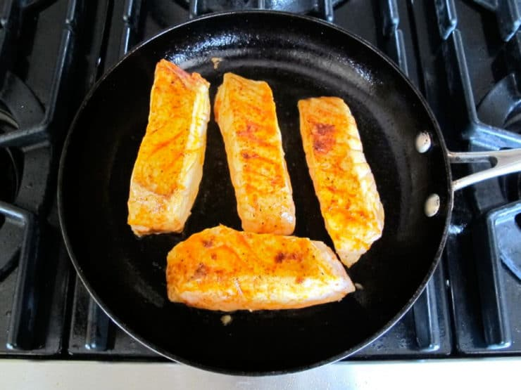 Sear fish fillets in a hot skillet.