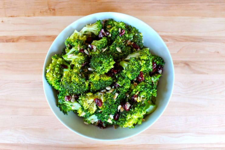 Crunchy Sweet Broccoli Craisin Salad - A simple, healthy, delicious make-ahead side dish with broccoli, dried cranberries, sunflower seeds, scallions and dressing. Vegetarian, Pareve.